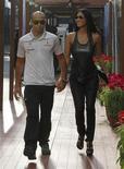 <p>Foto de archivo del piloto de McLaren Lewis Hamilton y Nicole Scherzinger en el Gran Premio de Singapur 2010. Hamilton confirmó el jueves que él y la cantante habían terminado su relación amorosa. Sep 26, 2010. REUTERS/Vivek Prakash</p>