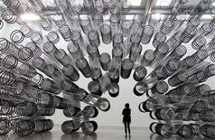 """<p>A woman looks at an art installation named """"Forever Bicycles"""" by dissident Chinese artist Ai Weiwei during a media preview of the """"Ai Weiwei Absent"""" exhibition in Taipei October 28, 2011. REUTERS/Pichi Chuang</p>"""