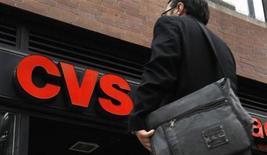 <p>A man walks outside CVS pharmacy in New York City July 28, 2010. REUTERS/Mike Segar</p>