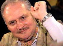 """<p>Ilich Ramirez Sanchez, better known as """"Carlos the Jackal"""", raises his fist as he appears in court in Paris, November 28, 2000. REUTERS/File</p>"""