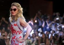 """<p>Madonna poses for photographers as she arrives on the """"W.E"""" red carpet at the 68th Venice Film Festival in Venice, September 1, 2011. REUTERS/Alessandro Garofalo</p>"""