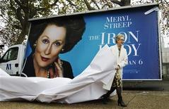 """<p>Actress Meryl Streep unveils a poster for her new film """"The Iron Lady"""" opposite the Housese of Parliament in central London November 14, 2011. The film is based on the life of former British Prime Minister Margaret Thatcher. REUTERS/Luke MacGregor</p>"""