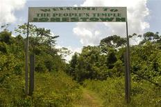 <p>A sign marks the entrance of a former temple at a site deep in the Guyanese rainforest in Jonestown November 18, 2011. REUTERS/Girish Gupta</p>
