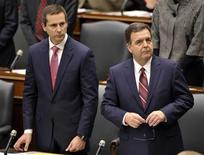 <p>Ontario Premier Dalton McGuinty and Minister of Finance, Dwight Duncan (R) stand after Lieutenant Governor of Ontario David Onley delivered the throne speech inside the Legislative chamber at Queen's Park in Toronto November 22, 2011. REUTERS/Mike Cassese</p>