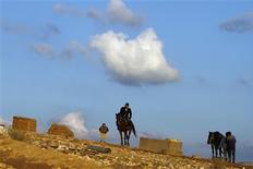 <p>A Bedouin man rides a horse in the village known by Bedouin Arabs as al-Arakib, one of dozens of ramshackle desert communities whose names have never appeared on any official map, November 6, 2011. REUTERS/Amir Cohen</p>