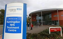 <p>People leave Hinchingbrooke Hospital in Huntingdon, eastern England November 3, 2011. Circle, a medical cooperative listed on the London stock market with ownership shared between its employees and international investment funds, will take over management of Huntingdon from February. The hospital's future had been in doubt since 2007 after it ran up debts of 39 million pounds on an annual turnover of just 100 million pounds, partly because a new treatment centre failed to attract as many patients as expected. REUTERS/Suzanne Plunkett</p>