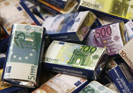 Chocolate bars in Euro banknote design are on display at a candy shop in Vienna, August 19, 2011. REUTERS/Heinz-Peter Bader/Files