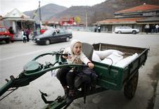 <p>A boy waits for his father as he sits in their vehicle in the southern Serbian town of Trgoviste November 8, 2011. REUTERS/Marko Djurica</p>