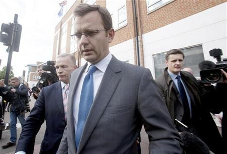 Andy Coulson, the former spokesman for Britain's Prime Minister David Cameron, leaves a police station after being bailed in South London July 8, 2011. REUTERS/Olivia Harris