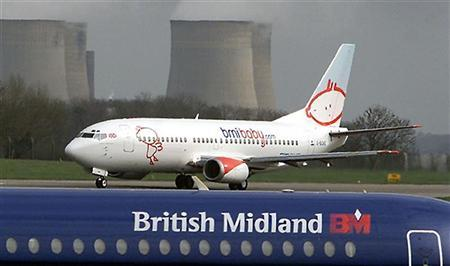 The first aircraft in the BMI Baby fleet takes off from East Midlands Airport, March 20, 2002. REUTERS/Darren Staples