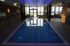 <p>A view of a pool at a spa facility at Mistral Hotel in Gniewino, Poland November 30, 2011. REUTERS/Peter Andrews</p>