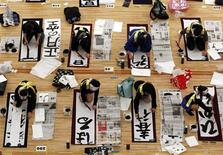 """<p>Participants write during a calligraphy contest to the celebrate the new year in Tokyo January 5, 2012. 2,999 calligraphers who were selected among 5,902 entrants, took part in the contest in the hope to win the """"Prime Minister's Prize"""". REUTERS/Kim Kyung-Hoon</p>"""