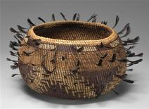 <p>A feathered basket from the early 20th century, made of plant fiber and quail feathers from Pomo, California is on display in New York in this photo provided to Reuters on January 17, 2012 by the Metropolitan Museum of Art in New York City. An exhibit of American Indian art at the Metropolitan Museum of Art throws the connection between art and collector into unusually sharp relief. The show features key pieces from The Coe Collection of American Indian Art, the life's work of a Ralph T. Coe, a collector and museum director who played a central role in reviving interest in American Indian art. REUTERS/Metropolitan Museum of Art/Handout</p>