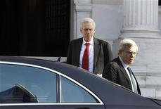 <p>Head of the Institute of International Finance (IIF) Charles Dallara (L) and his colleague Jean Lemierre leave the Greek Prime minister's office in Athens January 20, 2012. REUTERS/Yiorgos Karahalis</p>
