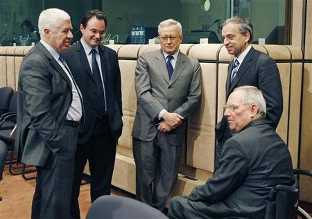 Finance Ministers from Portugal, Teixeira dos Santos, Greece, George Papaconstantinou, Italy, Giulio Tremonti, Cyprus Charilaos Stavrakis and Germany, Wolfgang Schaeuble (L-R) talk together at the start of an Eurogroup finance ministers meeting at the EU Council in Brussels January 18, 2010. REUTERS/Thierry Roge