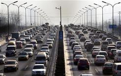 <p>Cars drive along a main road in central Beijing January 12, 2012. Car sales in China climbed 5.2 percent in 2011, the slowest pace since the nation's car culture took off at the turn of the century, as consumers shunned local brands after Beijing scrapped tax incentives for small cars. REUTERS/David Gray</p>