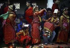 <p>Adorned Newar girls are pictured while performing rituals during an Ihi ceremony in Kathmandu January 28, 2012. REUTERS/Navesh Chitrakar</p>