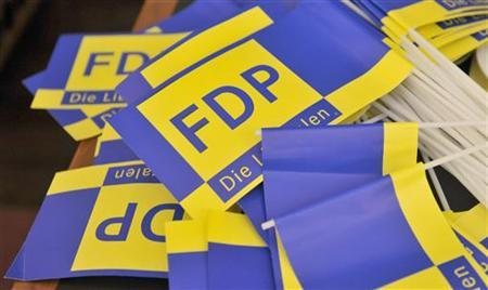Free Democratic Party (FDP) flags are left behind in the party headquarters after the state election in Bremen May 22, 2011. Voters in Germany's northern city-state of Bremen re-elected their current coalition government on Sunday and shifted further away from Chancellor Angela Merkel's conservatives, exit polls showed. REUTERS/Morris Mac Matzen (GERMANY - Tags: ELECTIONS POLITICS)