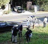 <p>Los Angeles police and news media are shown at the house of Don Cornelius in Los Angeles February 1, 2012. REUTERS/Gene Blevins</p>