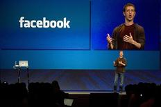 <p>Facebook founder Mark Zuckerberg delivers a keynote address at the company's annual conference in San Francisco, July 23, 2008. REUTERS/Kimberly White</p>