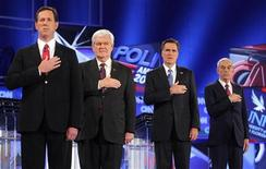 <p>Republican presidential candidates (L-R) former U.S. Senator Rick Santorum (R-PA), former Speaker of the House Newt Gingrich, former Massachusetts Governor Mitt Romney and U.S Representative Ron Paul (R-TX) stand for the national anthem before the Republican presidential candidates debate in Jacksonville, Florida January 26, 2012. REUTERS/Brian Snyder</p>