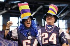 <p>New England Patriots fans enjoy themselves inside Lucas Oil Stadium before the start of the NFL Super Bowl XLVI football game against the New York Giants in Indianapolis, Indiana, February 5, 2012. REUTERS/Lucy Nicholson</p>