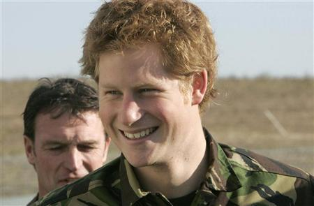Britain's Prince Harry (R) smiles during his visit to the Royal Navy's fleet diving squadron at Horsea Island in Portsmouth, southern England, October 31, 2007. REUTERS/Tim Ockenden/Pool
