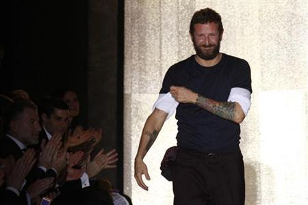 Italian designer Stefano Pilati appears at the end of his presentation for the Yves Saint Laurent Spring/Summer 2012 women's ready-to-wear fashion collection show in Paris October 3, 2011. REUTERS/Pascal Rossignol