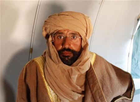 Gaddafi son attacked, misled - defence lawyer