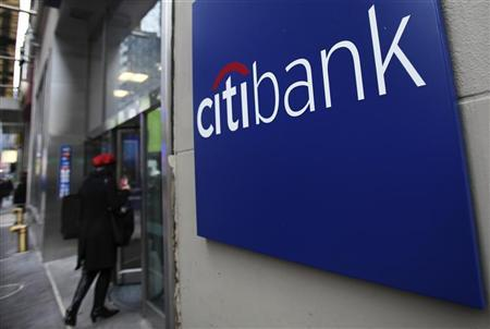 A woman walks into a Citibank branch in New York January 17, 2012. REUTERS/Shannon Stapleton