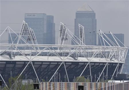 The Canary Wharf business district is seen behind the Olympic Park at Stratford, east London May 4, 2012. REUTERS/Toby Melville