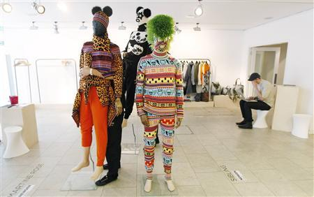 Workers arrange mannequins for the Sibling fashion presentation at ''London Collections: Men'', the first dedicated showcase of Britain's menswear in London, June 15, 2012. REUTERS/Suzanne Plunkett