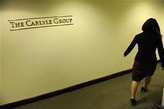 <p>Le fonds d'investissement Carlyle Group a conclu un partenariat avec la direction de Getty Images afin de racheter la première banque de photos, vidéos et produits multimédias du monde pour 3,3 milliards de dollars (2,69 milliards d'euros) auprès de Hellman & Friedman. /Photo prise le 3 mai 2012/REUTERS/Jonathan Ernst</p>