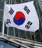 <p>La croissance de la Corée du Sud au deuxième trimestre a finalement été de 0,3% par rapport au premier et de 2,3% d'une année sur l'autre. /Photo prise le 16 août 2012/REUTERS/Yuriko Nakao</p>