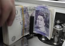 <p>Le produit intérieur brut (PIB) britannique a augmenté de 1,0% au troisième trimestre après une baisse de 0,4% au deuxième. /Photo d'archives/REUTERS/Sukree Sukplang</p>
