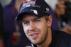 <p>L'Allemand Sebastian Vettel pourrait décrocher dimanche le titre de champion du monde de Formule Un pour la troisième année consécutive à l'occasion du retour de la F1 aux Etats-Unis sur le tout nouveau circuit d'Austin. /Photo prise le 1er novembre 2012/REUTERS/Darren Whiteside</p>