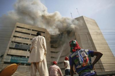 Men fall from building inferno