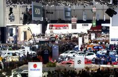 Au salon automobile de Genève. Selon l'Organisation internationale des constructeurs automobiles (OICA), le marché automobile mondial devrait enregistrer une croissance de 2% à 88 millions d'unités en 2014, tiré à nouveau par la forte progression de l'Asie. /Photo prise le 4 mars 2014/REUTERS/Arnd Wiegmann