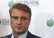 German Gref, Le directeur général de Sberbank, la première banque de Russie, a évoqué lundi une menace de récession pour le pays si les sorties de capitaux s'intensifiaient. /Photo prise le 24 mars 2014/REUTERS/Sergei Karpukhin