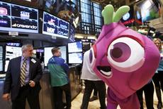 """L'action de King Digital Entertainment KING.N, le concepteur du jeu """"Candy Crush"""", a perdu jusqu'à 15% dans les premières cotations à la Bourse de New York mercredi, ramenant la valorisation de l'entreprise à environ six milliards de dollars (4,4 milliards d'euros). /Photo prise le 26 mars 2014/REUTERS/Brendan McDermid"""