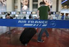 Air France a accepté l'offre de rachat de sa compagnie CityJet et de sa filiale VLM, présentée en décembre dernier par le groupe allemand Intro Aviation GmbH. Le montant de la transaction n'a pas été précisé. /Photo prise le 31 juillet 2013/REUTERS/Eric Gaillard