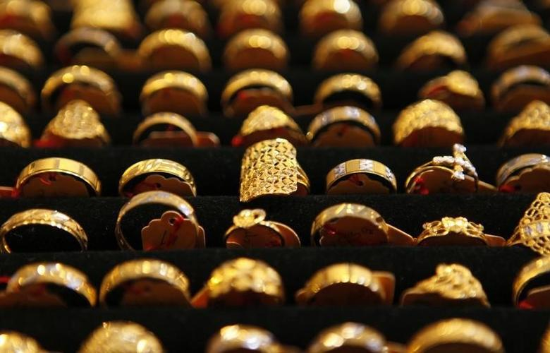 Gold rings are seen on display at a goldsmith shop in Kuala Lumpur April 21, 2011. REUTERS/Bazuki Muhammad/Files