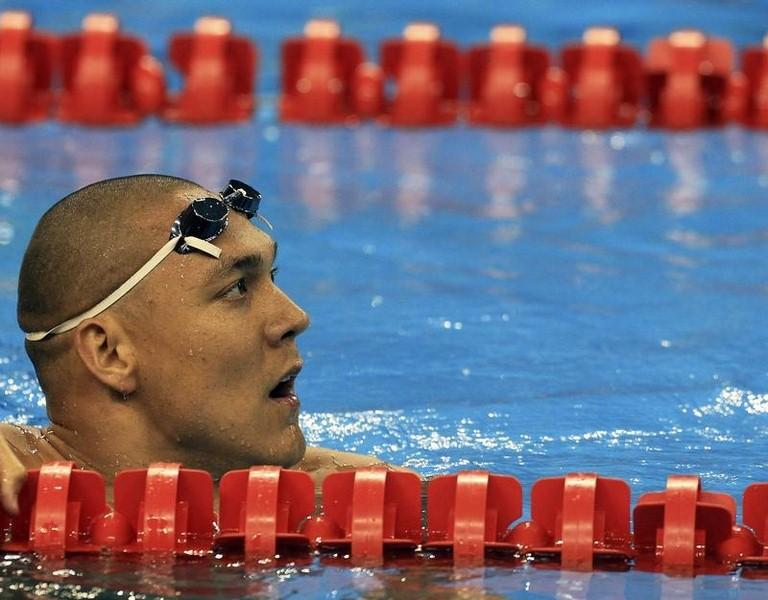 Australia's Geoff Huegill watches the scoreboard after competing in the men's 50m butterfly semi-final at the 14th FINA World Championships in Shanghai July 24, 2011.  REUTERS/Christinne Muschi (CHINA  - Tags: SPORT SWIMMING AQUATICS) - RTR2P85U