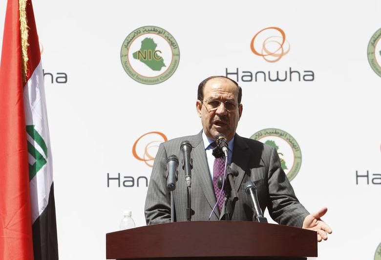 Iraqi Prime Minister Nouri al-Maliki speaks during a visit to a concrete plant for the Basmaya residential project in Baghdad April 16, 2014.   REUTERS/Ahmed Saad