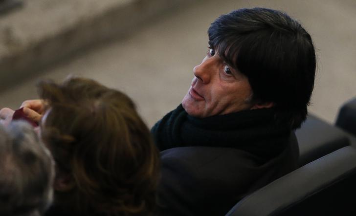 Germany's national soccer team coach Joachim Loew attends the German first division Bundesliga soccer match between Hertha Berlin and Bayern Munich in Berlin March 25, 2014.     REUTERS/Fabrizio Bensch