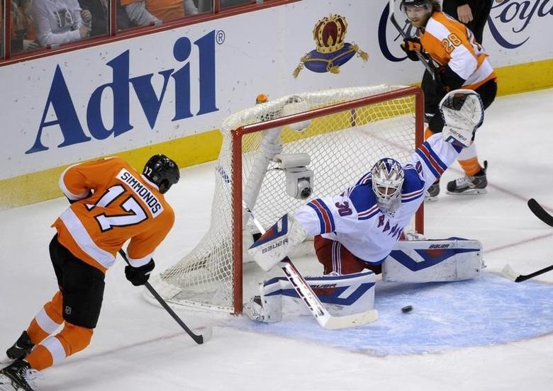 Apr 29, 2014; Philadelphia, PA, USA; New York Rangers goalie Henrik Lundqvist (30) makes a save against Philadelphia Flyers right wing Wayne Simmonds (17) during the first period in game six of the first round of the 2014 Stanley Cup Playoffs at Wells Fargo Center. Mandatory Credit: Eric Hartline-USA TODAY Sports