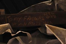 "A message is seen on the bottom of the ""Cross"", intersecting steel beams found in the rubble of 6 World Trade Center that was destroyed on September 11, 2001, displayed in The National September 11 Memorial and Museum, under construction, at the World Trade Center site in New York in this September 6, 2013 file photo.   REUTERS/Brendan McDermid/Files"