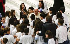 "Pope Francis talks with children during a special audience with members of the ""Catholic Action"" in Paul VI hall at the Vatican May 3, 2014.  REUTERS/Tony Gentile"