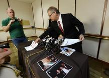 Jeff Herman (R), attorney for the anonymous victim in the allegation of child sexual abuse by Hollywood executives, displays photographs correspondences during a news conference in Beverly Hills, California May 5, 2014.  REUTERS/Kevork Djansezian