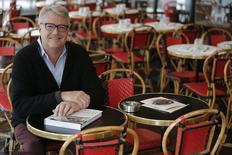 """American food critic and travel writer Alexander Lobrano poses with his latest book """"Hungry For France"""" in Paris, April 24, 2014.     REUTERS/Christian Hartmann"""
